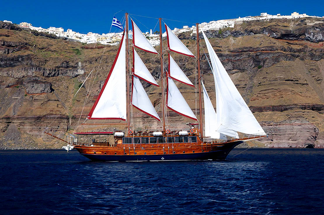 Afrodite wooden vessel sailing inside the Santorini caldera
