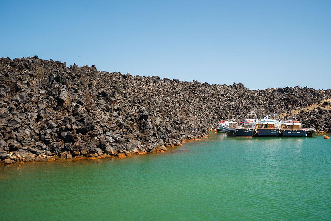 Santorini holidays, volcano trip, lava rocks